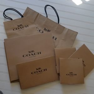 Asst. COACH Shopping bags and boxes.